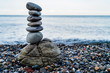 Stone tower of pebbles on sea shore