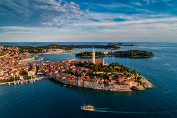 Beautiful Rovinj at sunset - HDR aerial view taken by a professional drone from above the sea. The old town of Rovinj, Istria, Croatia