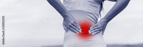 Back pain - woman having painful muscle injury in lower back Fototapet