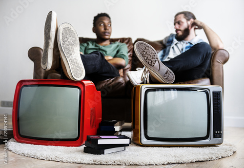 Two man sitting and two retro television Slika na platnu