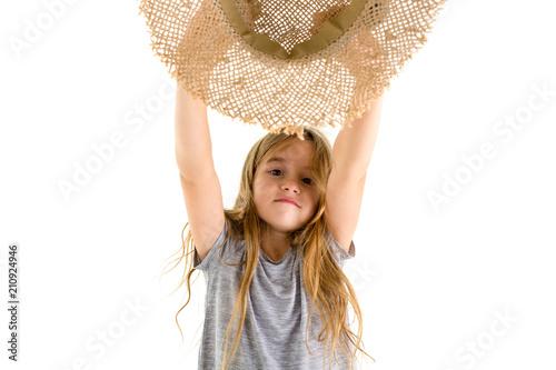 Fotografie, Obraz  Happy little girl cheering and waving her hat
