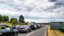 Vancouver-Blaine Hwy, Surrey, British Columbia, Canada. 06. 24. 2018 Long Line Up Cars At The Canada - US Peace Arch Border Crossing.