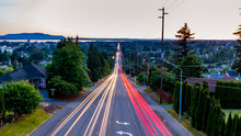 View From Above The City. Long Exposure Of Bellingham, Whatcom County.Cars Trail Lights And A Sublime View Of The Pacific Ocean In The Background.
