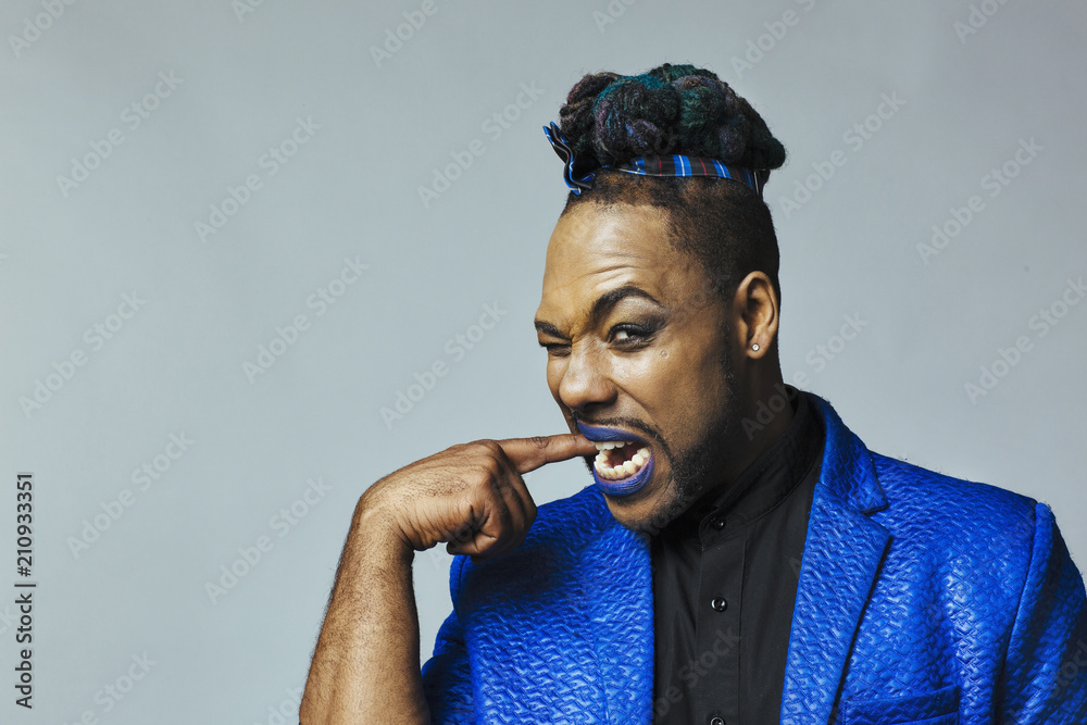 Fototapety, obrazy:  Portrait of a man in blue jacket and blue lips biting his finger