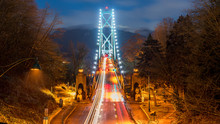 Lions Gate Bridge, North Vancouver, British Columbia - Canada. Long Exposure Of The Bridge On A Foggy Night.