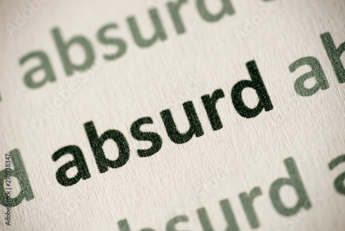 Photo word absurd printed on paper macro