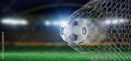 Futbolowa piłka w sieci cel - 3d rendering