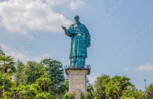 Tuinposter Historisch mon. San Carlo Borromeo colossus in Arona town, Novara province, Maggiore lake, Piedmont region, Italy. It is a statue over 30 meters high located in Arona, Novara.