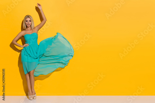 Tela Fashion Model In Turquoise Dress And High Heels