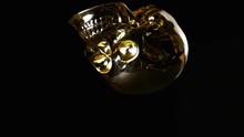 Golden Skull Ornament Falling ...