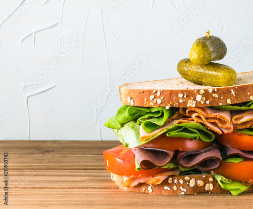 Fényképezés Deli sandwich with variety of meats on oat bread with turkey and black forest ha