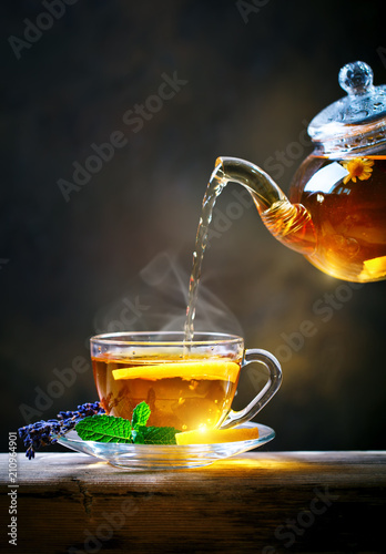 Process brewing tea,tea ceremony. Cup of freshly brewed black tea,warm soft light.