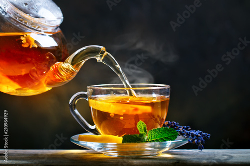 Poster Thee Process brewing tea,tea ceremony. Cup of freshly brewed black tea,warm soft light.