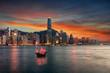 canvas print picture - Blick auf den Victoria Harbour und die beleuchtete Skyline von Hong Kong nach Sonnenuntergang