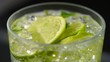 Mojito. Glass of mojito cocktail with rum, lime, mint, crashed ice and brown sugar rotated over black background. Rotation. 4K UHD video 3840x2160