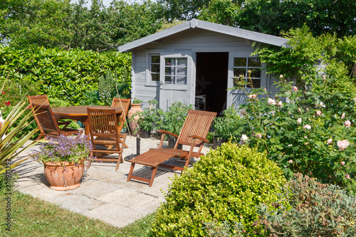 Cabanon avec terrasse et salon de jardin - Buy this stock photo and ...