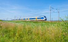 Train Riding Along A Field In ...