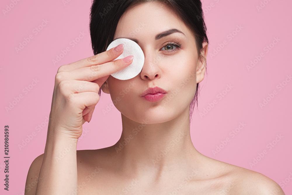 Fotografie, Obraz Beautiful woman with cotton pad in studio