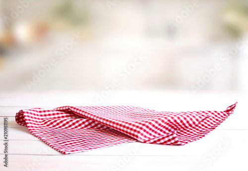 Checked red picnic cloth on table.