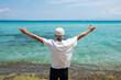 Senior man enjoying seaside view on summer vacation