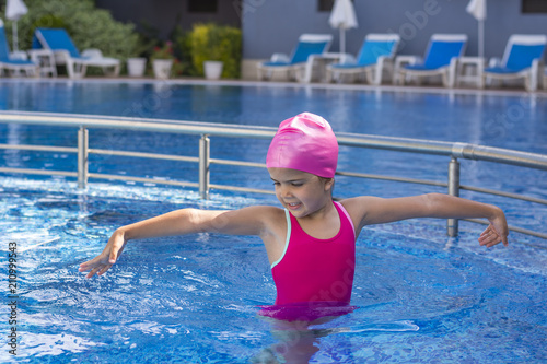 Fototapety, obrazy: Little girl dancing at the pool. Summer kid's games. Lifestyle concept.