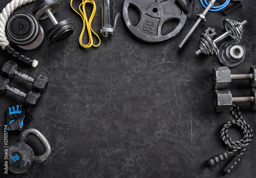 Sports equipment on a black background. Top view. Motivation. Copy space.