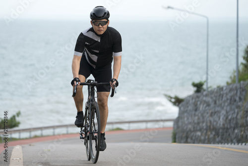 Asian men are cycling road bike in the morning.