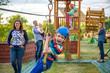 Leinwandbild Motiv Adorable little boy enjoying his time in a rope playground structure at adventure park,
