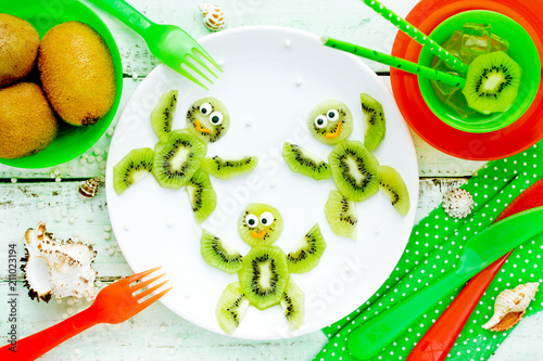 Creative idea for healthy food - kiwi turtles on plate