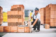 Industrial Worker Using Levele...