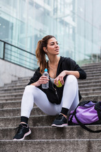 Athletic Woman With Apple And Water On Steps