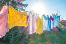Clothes Hanging To Dry On A Washing Line In A Back Garden