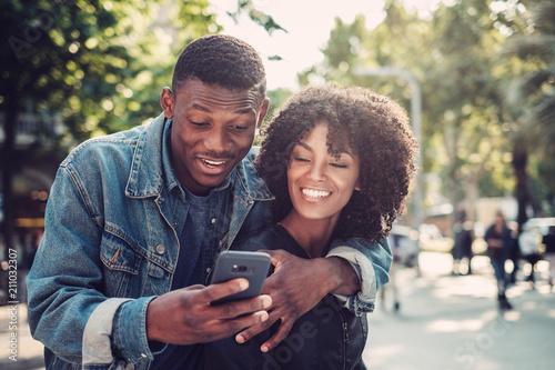 Fényképezés Young happy black couple outdoors