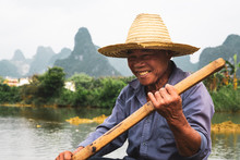 Chinese Man Sitting On Raft On Quây Son
