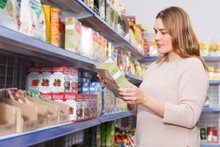 Smiling Woman Buyer With Assortment Of Grocery Food Store