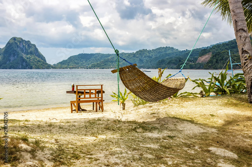 Wall Murals Bali A hammock between two palm trees on the beach. Beautiful beach. The concept of rest and recreation. Beautiful tropical island. Tropical beach.