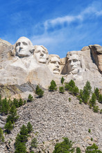 Presidential Sculpture At Mount Rushmore National Memorial, USA. Blue Sky Background. Vertical Layout.