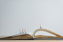 Miniature Chef Standing On Top Of Opened Recipe Book. Cooking Concept