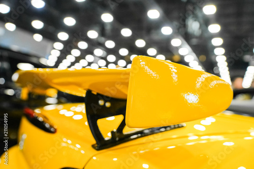 Yellow racing spoiler on the car Close-up Canvas Print