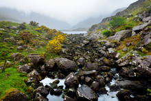 The River Loe And Narrow Mountain Pass Road Wind Through The Steep Valley Of The Gap Of Dunloe, County Kerry, Ireland