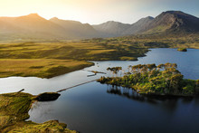 Twelve Pines Island, Standing On A Gorgeous Background Formed By The Sharp Peaks Of A Mountain Range Called Twelve Bens, County Galway, Ireland