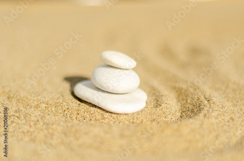Photo sur Plexiglas Zen pierres a sable zen meditation stone in sand, concept for purity harmony and spirituality, spa wellness and yoga background
