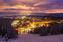 Ski Slopes And Mountain Town At Night