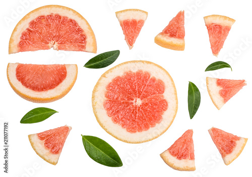 Stampa su Tela Shares of sliced grapefruit isolated on white, top view