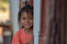 Smiling Faces Of Young Children Or Young People From Rural Asia.