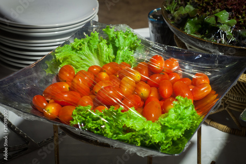 Poster Buffet, Bar Vegetable salad on plastic wrap for buffet line in wedding party.