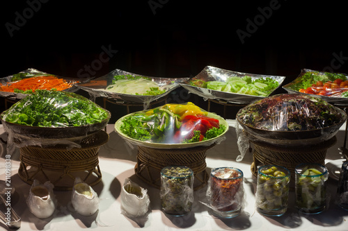 Photo sur Toile Buffet, Bar Vegetable salad on plastic wrap for buffet line in wedding party.