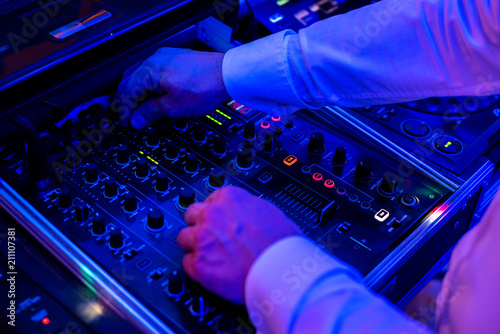 Fototapety, obrazy: DJ playing the mixer