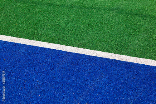 Synthetic hockey field sideline blue and green for background use