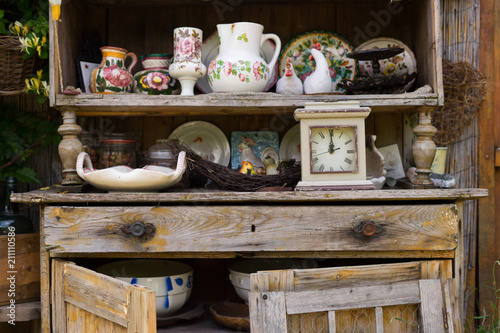 Garden Kitchen Tools And Flowerpots On Wood Shelf Background With